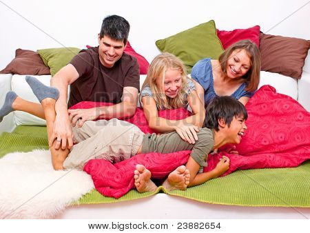 sweet young family having fun at home