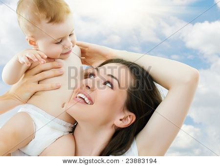 happy mother holding her baby