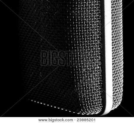 closeup of vintage microphone on black background