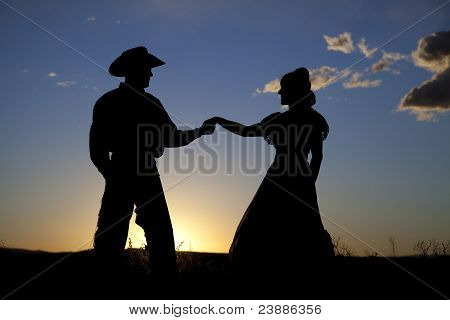 Cowboy Couple Silhouette Holding Hands