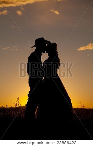 Cowboy Couple Silhouette Kiss