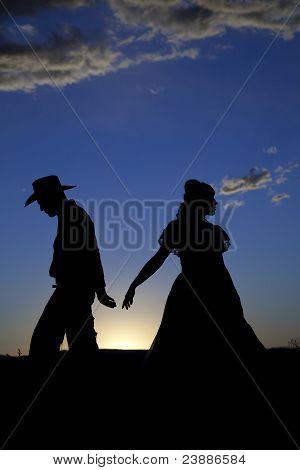Cowboy Couple Silhouette Walking Away