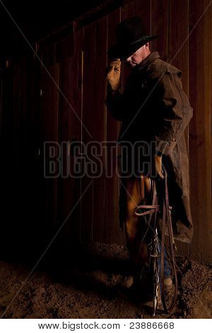 Cowboy Holding Bridle And Hat