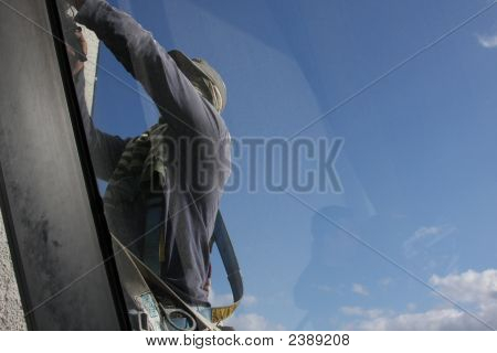 Man Fixing Window At Airport