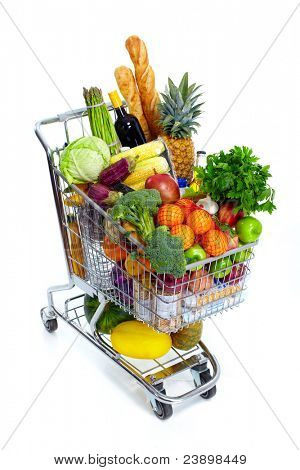 Metal shopping cart with grocery items. Isolated over white background.