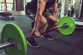 Cropped Image Of Sportsman Practicing Deadlift With Heavy Weight poster