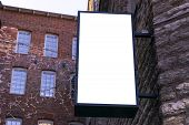 Blank White Billboard On City Street. In The Background Street And Building. Mock Up. Poster On Stre poster