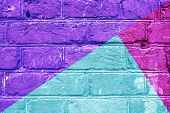 Textured Brick Wall With Bright Abstract Pattern Of Colored Triangles Of Green, Violet And Pink, Abs poster