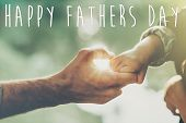 Happy Fathers Day Text, Greeting Card Concept. Father And Little Son Holding Hands In Sunlight In S poster