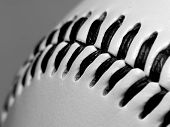 pic of welts  - Seam of a white baseball ball with white background.