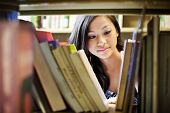 stock photo of asian woman  - A portrait of an Asian college student in library - JPG