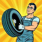 Male Car Mechanic With Wheel. Pop Art Retro Vector Illustration Comic Cartoon Kitsch Drawing poster