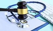 Gavel And Stethoscope. Medical Jurisprudence. Legal Definition Of Medical Malpractice. Attorney. Com poster