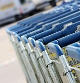 picture of parking lot  - many shopping carts in a row are waiting for using - JPG