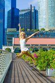 Elegant ballet dancer woman dancing ballet in the city of Singapore poster