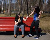 Fit Woman Motivating Her Overweight Friend For Weight Losing And Start Training. Friendship, Support poster