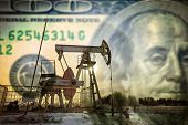 Oil Pump In A Snowy Field poster
