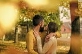 Couple In Love. Love Relationship And Romance. Man And Woman At Yellow Tree Leaves. Autumn Happy Cou poster
