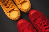 Young Adult People On A Love Date, Conceptual Image. Top View Of Two Pair Of Casual Sneakers, Yellow poster
