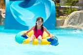 picture of inflatable slide  - 	Happy girl in pool - JPG