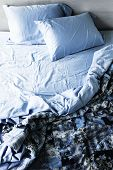 stock photo of pillowcase  - Unmade messy bed with wrinkled sheets from above - JPG