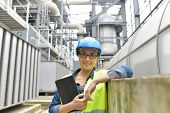 Industrial engineer standing in recycling plant poster