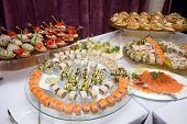 Japanese Cuisine -buffet Catering Style Sushi Set In Restaurant - Salmon Maki Sushi And Nigiri Sushi poster