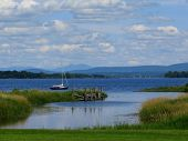 stock photo of burlington  - A boat passing by on Lake Champlain in Vermont - JPG