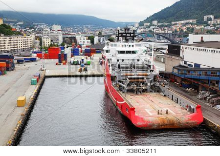 Large cargo ship are in dock in coastal city, many containers stand around