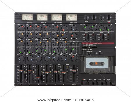 Vintage sound mixing board and cassette recording device isolated.