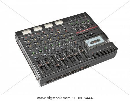 Retro sound mixing board and cassette recording device isolated.