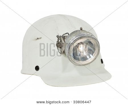 Vintage caving and mining hard hat with lamp isolated with clipping path.