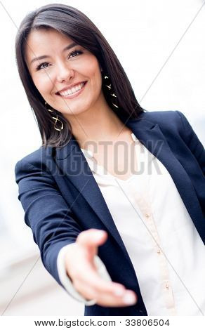 Business woman with hand extended to handshake