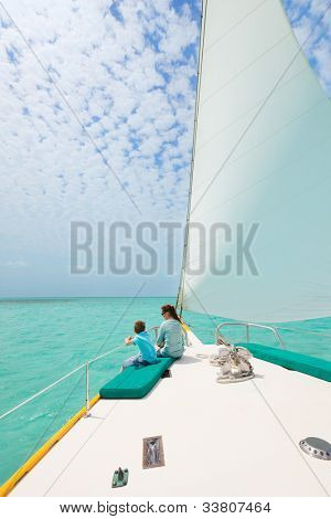 Mother and son relaxing while sailing on luxury yacht