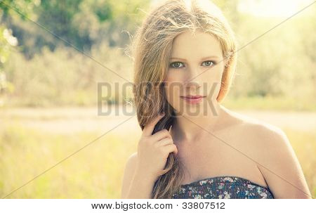 Beautiful Young Woman On The Nature Of The Summer