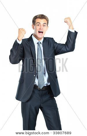 Business man throwing fists in air and smiling