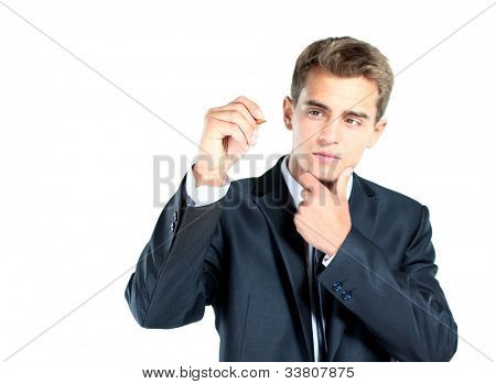 businessman writing something on glass board with marker
