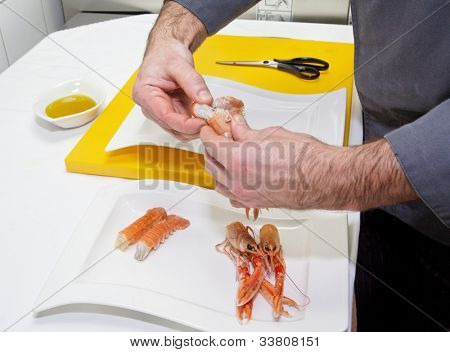 Chef is making seafood appetizer on professional kitchen