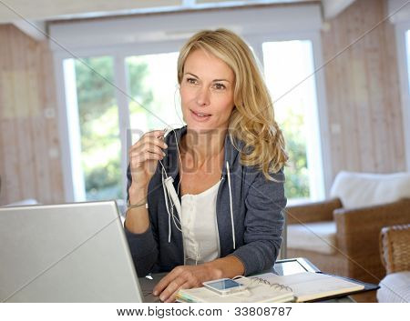 Attractive middle-aged woman working at home