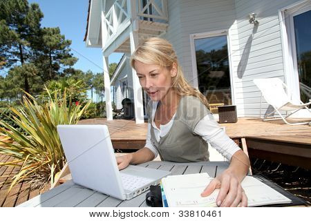 Teleworker in front of latptop computer at home