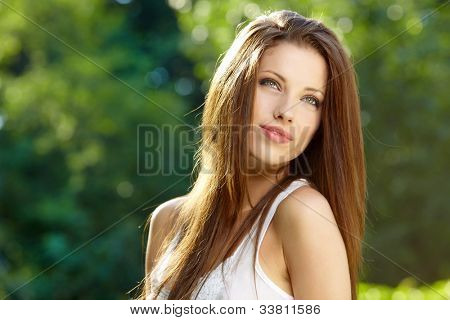 Portrait of an young beautiful sexy woman on the nature