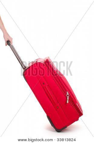 Reisetasche und Hand, isoliert auf weiss