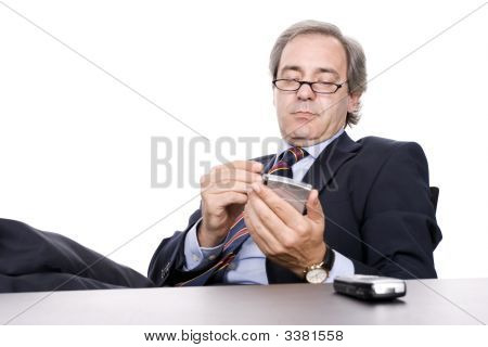 Mature Businessman Working With Pda