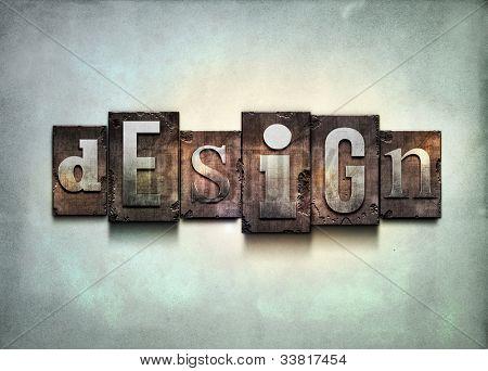 "The word ""design"". Random letterpress type on grunge background."