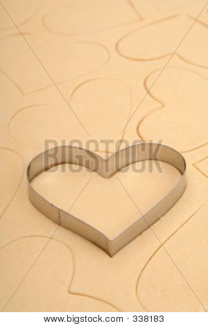 Heart Cookie Cutter On A Sheet Of Cookie Dough