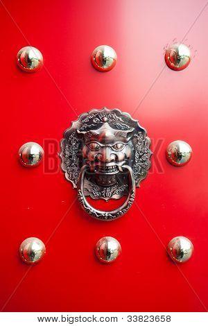 hand of lion on Oriental lion's door