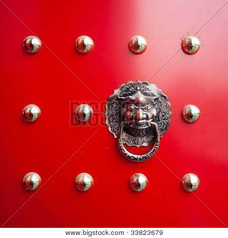 hand of lion on Oriental lion's door