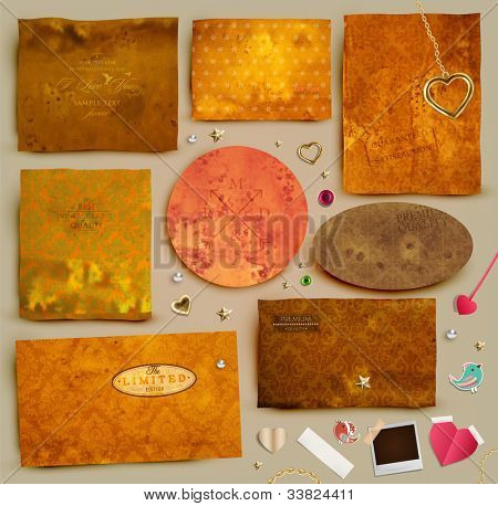 Scrapbooking set. Old paper textures: different aged paper elements for your layouts, golden hearts, stars, toggle and beads. Seamless floral ornaments collection.