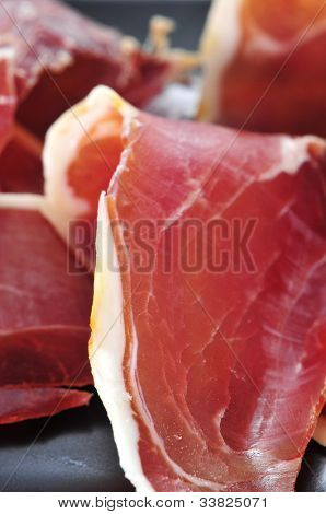closeup of a pile of spanish serrano ham served as tapas