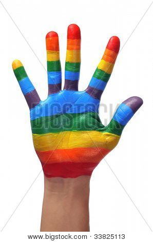 someone showing the palm of his hand painted as the rainbow flag
